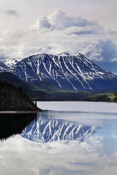 Mountain reflected in lake along the Yukon Highway, Canada
