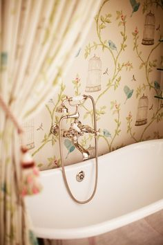 Pretty Bathroom and I love the wallpaper! by nola on indulgy.com. Love the bird cage!  Echoes curtain and tree in living room!