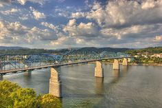 Walnut Street Bridge in Chattanooga, Tennessee reaches across the TN River: it is one of the longest pedestrian bridges in the world. Coolidge Park is located on the north shore of the bridge.