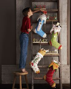 Hang stockings on a decorative ladder when you are rail and chimney-less!