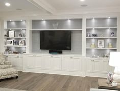We build custom built-ins in the Tampa area. Contact us today for a free design and quote on your very own custom unit. Built In Shelves Living Room, Living Room Wall Units, Bookshelves Built In, Home Living Room, Living Room Decor, Basement Built Ins, Custom Bookshelves, Room Shelves, Bookcases