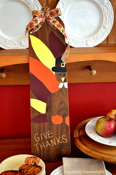 Paint a Thanksgiving turkey wooden sign on an old fan blade to welcome the holiday. It's an easy DIY and super cute, too.