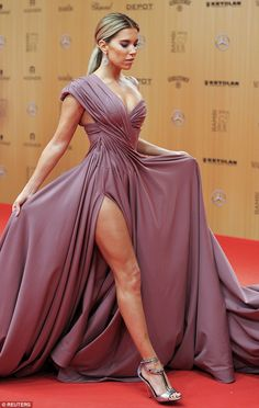 The former wife of football star Rafael van der Vaart, appeared at alongside Rita Ora and other stars at the glamorous annual Bambi Awards in Berlin, Germany on Thursday evening. Lovely Legs, Great Legs, Gala Dresses, Sexy Dresses, Sylvie Meis Style, Bambi Awards, Elegant Ponytail, Girl Celebrities, Glitz And Glam