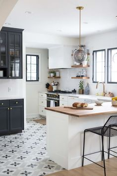 What a gorgeous monochromatic kitchen.