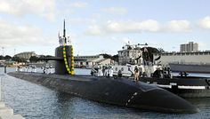 The Los Angeles-class attack submarine USS Olympia (SSN 717) moors at Joint Base Pearl Harbor-Hickam after returning from a seven-month deployment to the western Pacific region. (U.S. Navy photo by Mass Communication Specialist 2nd Class Steven Khor/Released)