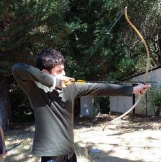 Colin Morgan shooting an arrow...so this is more attractive than it should be