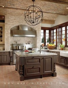 Mediterranean Kitchen with limestone tile floors, Flush, Kitchen island, U-shaped, Quartz, Glass panel, Chandelier