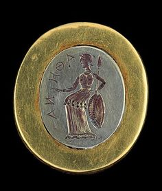 Tillia Tep - the kitten ring decorated with a representation of Athena, grave II Gold