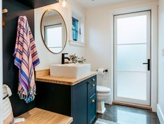 Design: Jill Ellis Creates Photographer: Jennifer Yau Location: Santa Barbara, CA Guest bathroom using Semihandmade Supermatte Night Sky Shaker fronts on Ikea cabinets