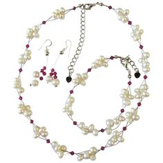 Price :$19.49 Freshwater Pearls Swarovski Fuchsia Crystals Bridal Bridesmaid Jewelry Material Used : Neklace Earrings & Bracelet - Freshwater Pearls with Genuine Swarovski Fuchsia Crystals 4mm Bicone Color : Off White / Pink Necklace Length : 16 inches with 2 inches extension Earrings Length : 1 3/4 inches long Earrings Type : Sterling Silver 92.5 french hook Bracelet Length : 7 1/4 inches with 1/2 inch extensionBracelet Type :Lobster Clasp