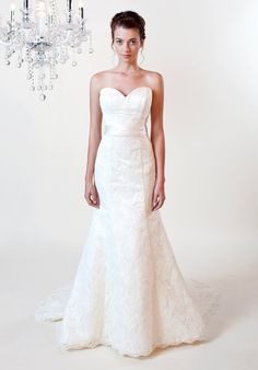 Gown features lace and silk sash.