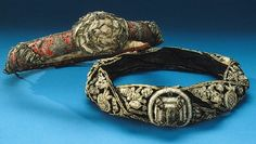 Two torse, or orles, used to decorate knightly class helmets.