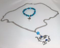 collar elefante y pulserita azul