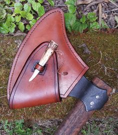Axe sheath...nice looking but the bone pin would be lost in minutes...need to design it into as attached. MXS