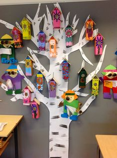 Milk carton birdhouses on paper birch tree- cool display!