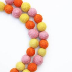 Check out this item in my Etsy shop https://www.etsy.com/uk/listing/533082935/pink-and-yellow-felt-ball-garland-pom