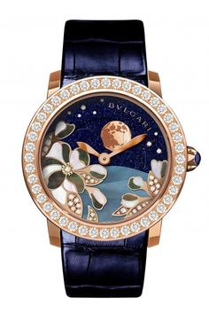 BVLGARI Bulgari Moonphase-18Kt polished pink gold case set with 36 brilliant-cut diamonds.Blue colour alligator leather strap with 18 kt pink gold ardillon buckle.