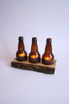 Beer Bottle Tea Light Candle on Waney Edge Oak (3) by AlliumUpcycle on Etsy