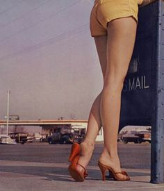 Posting mail. And showing legs.Like it's 1958.