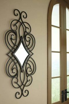 Adding simple elegance to your home is easy with this matte black finished metal mirror. The diamond shaped scroll design dresses up any wall in a snap. Wrought Iron Decor, Iron Wall Decor, Wall Art Designs, Wall Design, Metal Mirror, Wall Mirror, Iron Furniture, Iron Art, Scroll Design