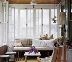 Enclosed porch with big awesome windows.