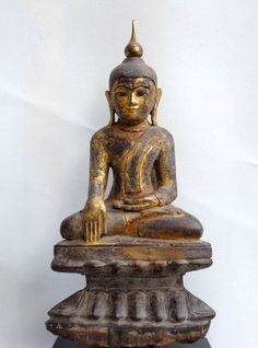 Wooden Burmese Buddha in bhumisparsa and padmasana