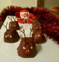Easy Santa sleigh Christmas decoration made from an egg box (with only paint, twigs and string)