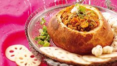 A traditional Indian dish of lamb mince with lotus seeds and greens served in a delicious bread shell. Plum Tomatoes, Cherry Tomatoes, Hard Bread, Clarified Butter, Lamb Recipes, Indian Dishes, Bread Rolls, Garam Masala, Family Meals