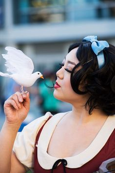 15 Amazingly Over-The-Top Female Cosplayers From Disney's Expo  #refinery29  http://www.refinery29.com/2015/08/92552/women-cosplay-costumes-d23-expo#slide-3  Snow White and one of her forest animals. ...