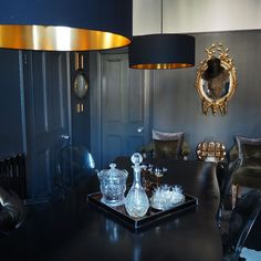 House Tour - Rachel Edmonds. Dining room inspiration. Moody interiors. Dark, rich colours with gold accents