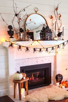 Neutral and glam Halloween mantel decorating idea. Create this simple and easy halloween display using black and white decor. #halloweenmantel #halloweendecorating