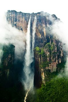 Angel falls Angel Falls is a waterfall in Venezuela. It is the world's highest waterfall, with a height of 979 m ft) and a plunge of 807 m ft). Angel Falls is one of Venezuela's top tourist attractions, though a trip to the falls is a complicated affair. Beautiful Waterfalls, Beautiful Landscapes, Famous Waterfalls, Angel Falls Venezuela, Places To Travel, Places To See, Travel Destinations, Places Around The World, Around The Worlds