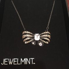 """Bow necklace 18"""" rope chain necklace with a detachable crystal embellished bow. The bow can be removed to use as a hairpin or brooch. Jewelmint Jewelry Necklaces"""