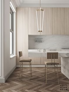 herringbone floor. Elegant kitchen. Modern kitchen with white marble and light wood cabinets.