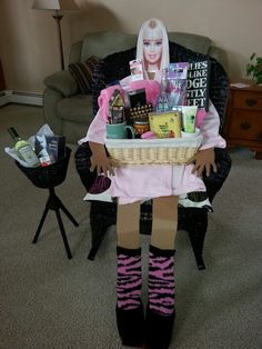 Fundraiser basket mommy's time out chair..bottle of mommy's time out wine, fifty shades of Grey trilogy and Asprin. Life size card board cut out with a down loaded photo of Barbie doll