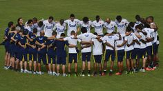 Colombian players pray before the start of a training session at the Metropolitan Stadium in Barranquilla on June 9, 2013. Colombia will face Peru next June 11 for a FIFA World Cup Brazil 2014 South American qualifier match. AFP PHOTO/Luis Acosta