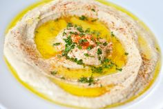 Nutty and smooth hummus, flavored with fruity extra virgin olive oil....Heaven on earth.
