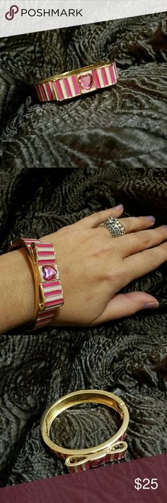Betsey Johnson pink bow bracelet In excellent condition.  Hinged bracelet. No damage to report. It's dark and light pinks  and good. Betsey Johnson Jewelry Bracelets
