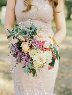 spring wedding bouquet - photo by Emily Katharine Photography http://ruffledblog.com/watercolor-wedding-at-ever-after-barn