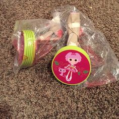 La La Loopsy  Training Wheels Kids training wheels. I don't see any bolts or screws inside packaging. Magenta and lime green with pastel pink on metal part. New in plastic Other