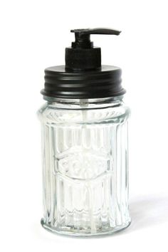 "Hoosier Soap Dispenser. 3"" diameter, 7¾"" high. One of our most popular soap dispensers. This jar reads: Soap. Clear glass with a black lid.   Soap Dispenser by Colonial Tinworks. Home & Gifts - Gifts - Scents & Bath South Carolina"