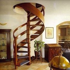"<p>The graceful curves of <a rel=""nofollow"" href="" http://www.bobvila.com/sculptural-elegance/47082-stairs-with-a-twist-11-spiral-designs-you-ll-love/slideshows"" title=""http://www.bobvila.com/sculptural-elegance/47082-stairs-with-a-twist-11-spiral-designs-you-ll-love/slideshows"" target=""_blank"">this spiral staircase</a> are made all the more dramatic with a rich wood railing that follows the arc completely. Fashioned entirely from the same wood, the sinuous structure is simple, beautiful…"