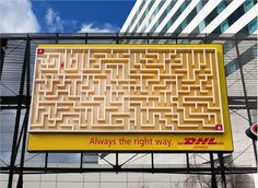 DHL Maze - A huge three-dimensional billboard measuring was installed directly in front of Schiphol Airport's main entrance. A small ball rolls from point A to B via the shortest route. At the end of its journey, the ball is transported by an invisible conveyor belt within the billboard back to the top to repeat the process, along the same route, again and again. This was done to get the attention of business travelers at Schiphol Airport, where 11 million people pass through each year.