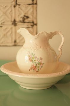 Arnel's pottery LARGE vase and bowl wash basin set...shabby and pink w/ floral.  We have the same one without the floral pattern.