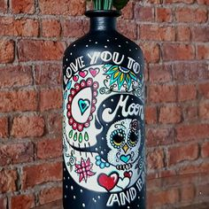 'I love you to the Moon and back' Mexican Day of the Dead Sugar Skull decorated glass bottle. Candleholder/vase.
