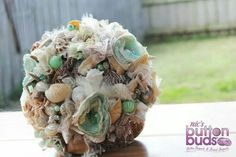 Absolutely beautiful the green is my wedding colour and im going to have a beach wedding as I live in a beach town. Stunning work the detail is this piece is amazing. U do a beautiful job on all ur work @nicsbuttonbuds