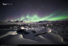 Northern Lights over the frozen Arctic fiord (Hornsund)