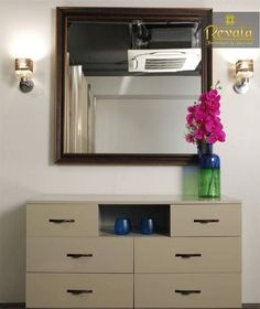 Storage ✨ Cabinet with Chest of Drawers with Metal Handles, Open Display Cabinet, Flower Vase & Wall Mounted Mirror ✨ with Decorative Wall Lights on each side - GharPedia Tiny Bedroom Design, Storage Units, Wall Mounted Mirror, Cabinet Design, Chest Of Drawers, Windows And Doors, Floating Nightstand, Wall Lights, Wall Decor