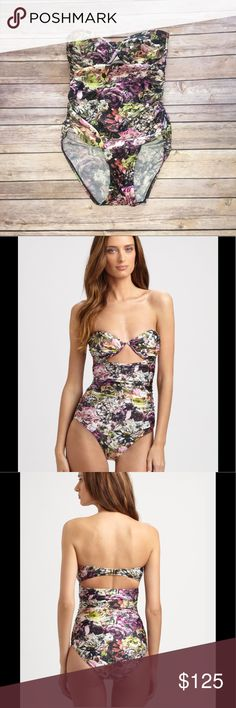 Zimmermann one piece floating swimsuit sz 6 A one-piece swimsuit blooms with graphic flowers for a sweet, feminine look, as gathered sides and angled cutouts add a sexy finish. Ruching accents the lightly padded underwire cups. A polished buckle closes the back.   Bandeau bustline with lightly padded underwire cups Cutout detail at center bust Ruched side seams Snap clasp closure in back with cutout below Nylon/Lycra® spandex Hand wash  US Size 6  Detachable straps NOT included  Lined in…
