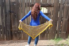 Gilded Frame is a classic top down crescent triangle shawl.